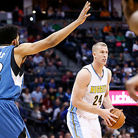 15 February 2017: Denver Nuggets center Mason Plumlee (24) looks to pass the ball past Minnesota Timberwolves center Karl-Anthony Towns (32) during the Minnesota Timberwolves 112-99 victory over the Denver Nuggets, at the Pepsi Center, Denver, Colorado, USA.