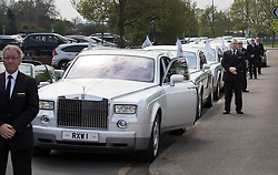 © Licensed to London News Pictures. 21/04/2018. Cobham, UK. A line up of Silver Roll-Royce cars is readied for the funeral of Queenie, Elizabeth Doherty at Sacred Heart Church in Cobham, Surrey. Elizabeth Doherty, whose son Paddy Doherty is known for appearing on My Big Fat Gypsy Wedding and winning Celebrity Big Brother 8, died of a heart attack earlier this month. Paddy Doherty claimed his mother has died of a 'broken heart' following the death of her husband almost a year ago. Photo credit: Peter Macdiarmid/LNP
