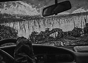 """Débarcadère du PK6, lac de retenue du barrage de Petit-Saut, Guyane, 2015.<br /> <br /> Le village de Saint-Elie reste pratiquement inaccessible par des moyens légaux. En l'absence de  piste d'atterrissage pour les  avions, on ne s'y rend qu'en hélicoptère, ou alors depuis la route nationale du littoral, en empruntant un chemin de 27 km tracé dans la forêt, (en principe seulement autorisé aux agent EDF), jusqu'au barrage de Petit-Saut. Il traverser en pirogue le lac de retenue du barrage jusqu'au débarcadère du PK6 et après une heure et demie de navigation, terminer en 4×4 26 km de piste, ce trajet par la """"route"""" peut durer de 6 heures à 2 jours selon la saison."""