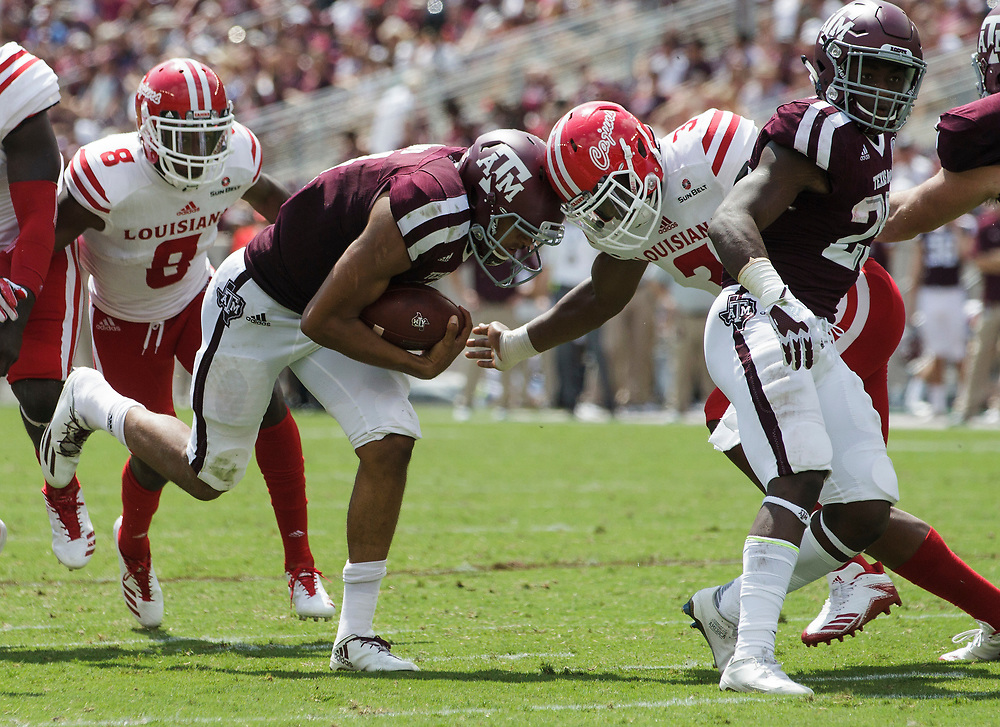 Texas A&M quarterback Kellen Mond (11) goes head to head with Louisiana-Lafayette defensive end Joe Dillon (3) near the goal line during the second quarter of an NCAA college football game Saturday, Sept. 16, 2017, in College Station, Texas. (AP Photo/Sam Craft)