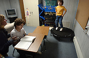Adam Jones, right, age 7, and Jeffrey Jones, age 9, are seen with their private tutor/therapist Edith Conroy in the basement of their home that they use as a classroom in Toms River, NJ. Adam jumps on a trampoline to calm himself down.<br /> Adam Jones, age 7, and Jeffrey Jones, age 9, are two brothers out of 6 siblings that have different forms of autism . Their family integrates them into all forms of daily life, which include little league, physical therapy, private tutoring sessions and family meals. Every year it costs around $50,000 per child to get them the help they need to become more socialized.