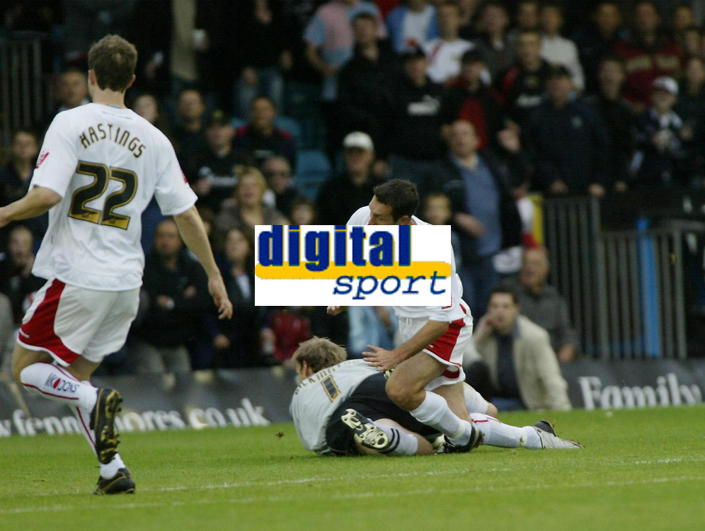 Photo: Marc Atkins.<br /> <br /> Milton Keynes Dons v Notts County. Coca Cola League 2. 02/09/2006. Scott Taylor (C) clashes with Notts County keeper Kevin Pilkington whilst scoring.
