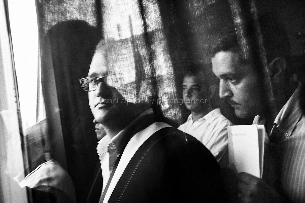The newly elected mayor Salvatore Gambino (left) waits to step outside on the porch of the town hall to give his inaugural address in Torretta, a village in the province of Palermo, Sicily, Italy, on June 16th 2016.<br /> <br /> In 2007, three former employees of the Torretta town hall were, suspected of allowing Mafia members to infiltrate.<br /> <br /> Already in 2005, the suspected infiltration prompted the Interior Ministry of Italy to dissolve Torretta's municipal council.