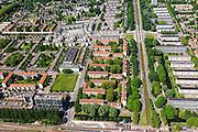 Nederland, Noord-Holland, Amsterdam, 14-06-2012; Slotervaart met de Cormelis Lelylaan en de flats aan de Comeniusstraat (rechts).  In het midden (vlnr) Johan Huizingalaan. In het midden van boven naar beneden de Pieter Calandlaan, langs het Sierplein..This residential area (Slotervaart) is an example of garden cities of Amsterdam-west. Constructed on the basis of the General Extension Plan for Amsterdam (AUP, 1935). Example of the New Building (het Nieuwe Bouwen), detached in strips, oblong housing blocks alternated with green areas, built in fifties and sixties of the 20th century. ..luchtfoto (toeslag), aerial photo (additional fee required).foto/photo Siebe Swart