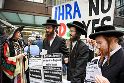© Licensed to London News Pictures. 04/09/2018. London, UK. A member of the group Labour Against The Witch-hunt, dressed as a which, stands next to a member of the Jewish Community, outside Labour Party headquarters in London ahead of a National Executive Committee meeting. The Labour Party's ruling body is expected to vote on whether to adopt, in full, the IHRA (International Holocaust Remembrance Alliance) definition of anti-Semitism. Photo credit: Ben Cawthra/LNP
