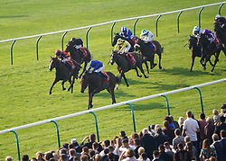 William Buick riding Coroebus (centre, blue cap) on their way to winning the Emirates Autumn Stakes at Newmarket Racecourse. Picture date: Friday October 8, 2021.