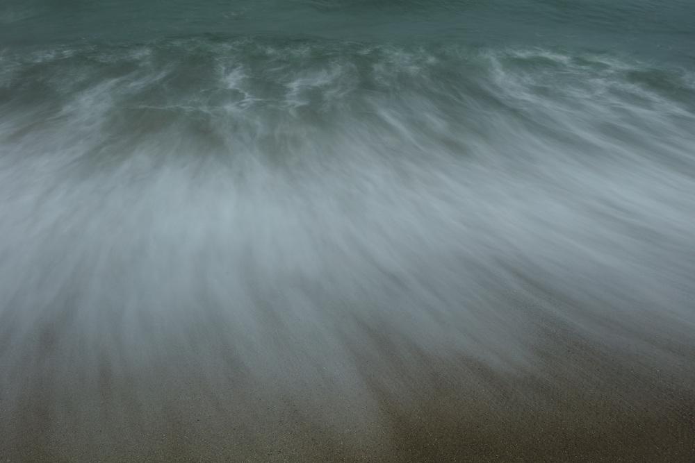 Waves gliding onto the sandy shores at Cisco.