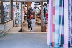 THEMENBILD - ein Frau mit MNS Maske in einem Geschäft während der Corona Pandemie, aufgenommen am 17. April 2019 in Hallstatt, Österreich // a woman in an MNS mask in a shop. during the Corona Pandemic in Hallstatt, Austria on 2020/04/17. EXPA Pictures © 2020, PhotoCredit: EXPA/ JFK