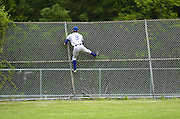 Fairfield Ludlowe's Jonathan Servilla watches Westhill's Stanley Paul's home run sail over the right field fence during an FCIAC baseball games against Fairfield Ludlowe High School in Stamford, Conn. on Tuesday, May 26, 2009.
