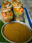 07 OCTOBER 2014 - GEORGE TOWN, PENANG, MALAYSIA: Vietnamese style spring rolls at a restaurant in George Town (also Georgetown), the capital of the state of Penang in Malaysia. Named after Britain's King George III, George Town is located on the north-east corner of Penang Island. The inner city has a population of 720,202 and the metropolitan area known as George Town Conurbation which consists of Penang Island, Seberang Prai, Kulim and Sungai Petani has a combined population of 2,292,394, making it the second largest metropolitan area in Malaysia. The inner city of George Town is a UNESCO World Heritage Site and one of the most popular international tourist destinations in Malaysia.         PHOTO BY JACK KURTZ