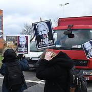 Activists from Frence, Gemany, Netherland protestor for freedom of speech for Global Protest - Free Assage road blockade in outside the Woolwich Crowd Court London, UK.