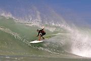OCTOBER 6, 2010: Dane Pioli in a barrel at Snapper Rocks on the Gold Coast on 6 October, 2010. Photo by Matt Roberts