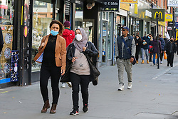 © Licensed to London News Pictures. 19/10/2020. London, UK. Women wearing face coverings in north London as tougher measures are put in place in the capital to manage increasing cases. Over 10,000 people in London have  tested positive for COVID-19 in the past week. Photo credit: Dinendra Haria/LNP