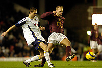 Photo: Leigh Quinnell.<br /> Arsenal v Portsmouth. The Barclays Premiership.<br /> 28/12/2005. Portsmouths Brian Priske challenges Dennis Bergkamp.