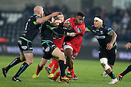 Junior Rasolea of Edinburgh Rugby © tries to break past Brendon Leonard (9), Sam Davies and Josh Matavesi of the Ospreys ®. Guinness Pro12 rugby match, Ospreys v Edinburgh Rugby at the Liberty Stadium in Swansea, South Wales on Friday 2nd December 2016.<br /> pic by Andrew Orchard, Andrew Orchard sports photography.