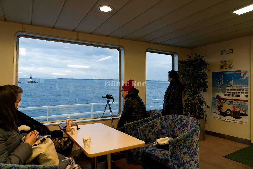 New years sunrise viewing on the Tokyo-Wan ferry between Chiba and Yokosuka Kanagawa prefecture Japan