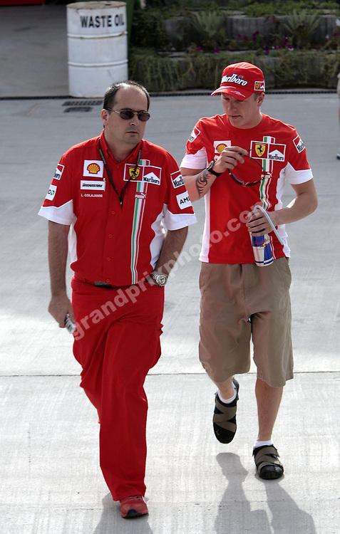 Ferrari press officer Luca Colajanni and Kimi Raikkonen in the paddock before the 2007 Bahrain Grand Prix. Photo: Grand Prix Photo