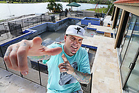 Rob VanWinkle (Vanilla Ice) poses near the infinity pool designed by Cushing Pools in the backyard of the home in Wellington, FL.  As seen on The Vanilla Ice Project. (before) (portrait) (exterior)