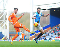 Blackpool's Gary Madine vies for possession with Blackburn Rovers' Grant Hanley<br /> <br /> Photographer Chris Vaughan/CameraSport<br /> <br /> Football - The Football League Sky Bet Championship - Blackburn Rovers v Blackpool - Saturday 21st February 2015 - Ewood Park - Blackburn<br /> <br /> © CameraSport - 43 Linden Ave. Countesthorpe. Leicester. England. LE8 5PG - Tel: +44 (0) 116 277 4147 - admin@camerasport.com - www.camerasport.com