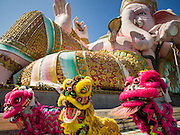 20 SEPTEMBER 2015 - SARIKA, NAKHON NAYOK, THAILAND:  Chinese Lion Dancers perform for Ganesha at the Ganesh festival at Shri Utthayan Ganesha Temple in Sarika, Nakhon Nayok. Ganesh Chaturthi, also known as Vinayaka Chaturthi, is a Hindu festival dedicated to Lord Ganesh. Ganesh is the patron of arts and sciences, the deity of intellect and wisdom -- identified by his elephant head. The holiday is celebrated for 10 days. Wat Utthaya Ganesh in Nakhon Nayok province, is a Buddhist temple that venerates Ganesh, who is popular with Thai Buddhists. The temple draws both Buddhists and Hindus and celebrates the Ganesh holiday a week ahead of most other places.   PHOTO BY JACK KURTZ