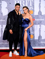 Alex Oxlade-Chamberlain and Perrie Edwards attending the Brit Awards 2019 at the O2 Arena, London.