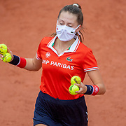 PARIS, FRANCE September 29. A ball girl in action during the Sofia Kenin of the United States match against Liudmila Samsonova of Russia in the first round of the singles competition on Court Suzanne Lenglen during the French Open Tennis Tournament at Roland Garros on September 29th 2020 in Paris, France. (Photo by Tim Clayton/Corbis via Getty Images)