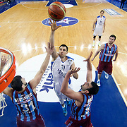 Anadolu Efes's Milko Bjelica (C) during their BEKO Basketball League match Anadolu Efes between Trabzonspor at Abdi Ipekci Arena in Istanbul Turkey on Sunday 23 February 2014. Photo by Aykut AKICI/TURKPIX