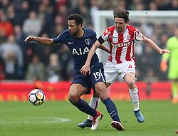 Stoke City's Joe Allen (right) and Tottenham Hotspur's Moussa Dembele battle for the ball