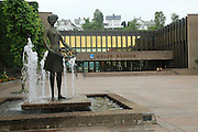 Town hall 'Radhus' building in town centre of Molde, Romsdal county, Norway with water fountain sculpture