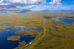 Aerial view of Lochan na h-Achlaise and A82 road crossing Rannoch Moor in summer, Loch Ba top right, Scotland, UK