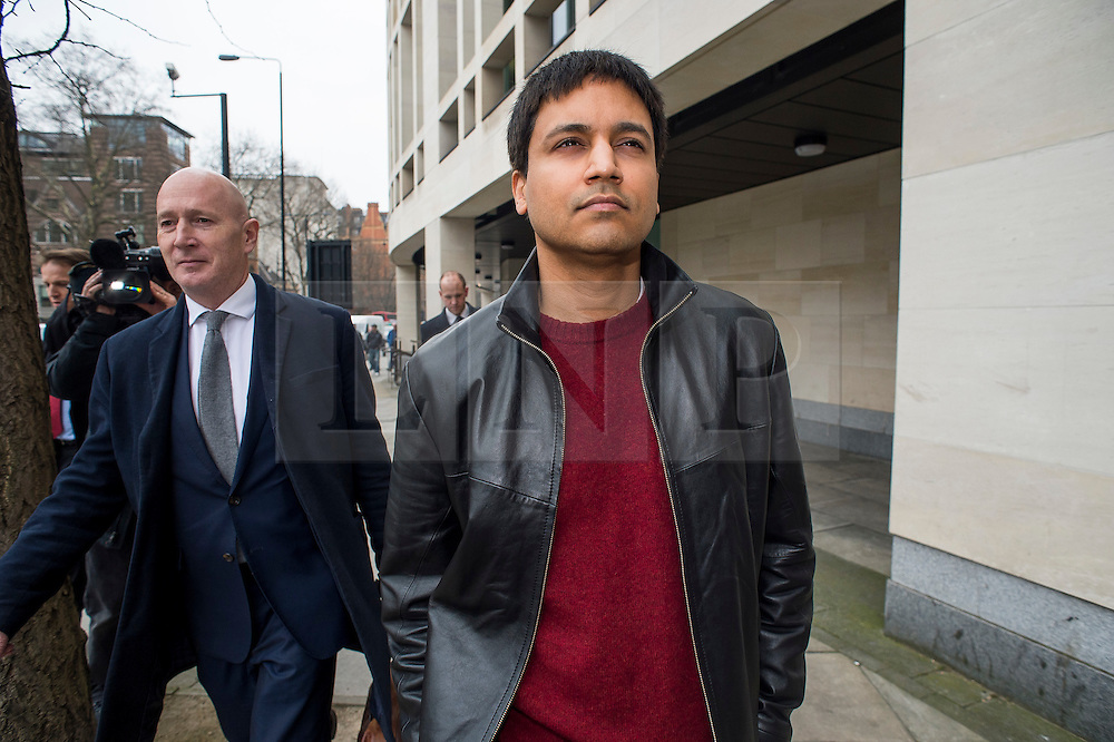 """© Licensed to London News Pictures. 23/03/2016. London, UK.""""Flash crash"""" Trader NAVINDER SINGH SARAO (right) leaves Westminster Magistrates court in London where a Judge has ruled that he should be extradited to the USA. Sarao, nicknamed the Hound of Hounslow, is accused of contributing to the 2010 flash crash. He has been charged with 22 counts of fraud and market manipulation by the US authorities who want to extradite him. Photo credit: Ben Cawthra/LNP"""