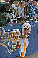 Washington's Santana Moss signs autographs for fans, following the Redskins 24-9 win over the St. Louis Rams at the Edward Jones Dome in St. Louis, Missouri, December 4, 2005.