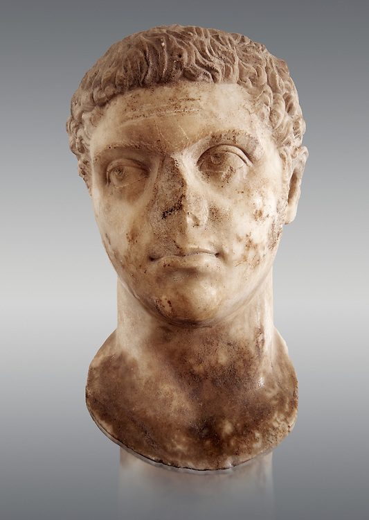 Roman sculpture of the Emperor Caracalla, excavated from Thuburbo-Majus, sculpted circa 211-217AD. The Bardo National Museum, Tunis, Inv No: C. 1347.   Against a grey background. .<br /> <br /> If you prefer to buy from our ALAMY STOCK LIBRARY page at https://www.alamy.com/portfolio/paul-williams-funkystock/greco-roman-sculptures.html . Type -    BARDO    - into LOWER SEARCH WITHIN GALLERY box - Refine search by adding a subject, place, background colour, museum etc.<br /> <br /> Visit our CLASSICAL WORLD HISTORIC SITES PHOTO COLLECTIONS for more photos to download or buy as wall art prints https://funkystock.photoshelter.com/gallery-collection/The-Romans-Art-Artefacts-Antiquities-Historic-Sites-Pictures-Images/C0000r2uLJJo9_s0c