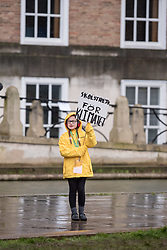 © Licensed to London News Pictures. 28/02/2020. Bristol, UK. KATIE SCAIFE aged 9, dressed in a coat like environmental activist Greta Thunberg's, holds a placard at the rally march at the Bristol Youth Strike 4 Climate where Greta spoke to thousands of people and joined a march through the city. Greta Thunberg started the Youth Strike 4 Climate protest movement in her home country of Sweden when she sat alone outside the Swedish parliament, eventually paving the way for the Fridays for Future movement across the world. Thousands of people are expected to attend the event in Bristol with many roads closed in the city centre. In 2018 Bristol was the first city to declare a climate emergency and also the first to declare an ecological emergency just four weeks ago. Photo credit: Simon Chapman/LNP.