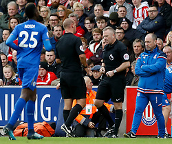 Match referee Bobby Madley (centre left) leaves the game and  colleague Jon Moss (centre right) takes over as referee