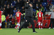 Cardiff manager Russell Slade celebrates his side's victory at full time.<br /> <br /> Skybet Football League Championship match, Cardiff City v Ipswich Town at the Cardiff city stadium in Cardiff, South Wales on Tuesday 21st October 2014<br /> pic by Mark Hawkins, Andrew Orchard sports photography.