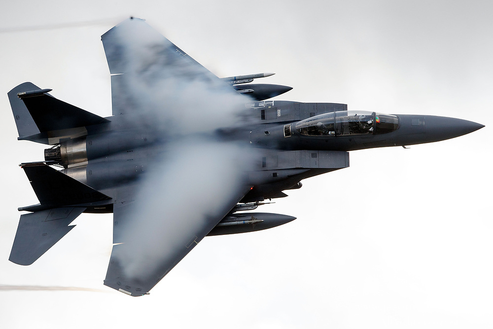 United States Air Force McDonnell-Douglas F-15E Strike Eagle (LN 12-002) from the 48th Fighter Wing, 494th Fighter Squadron based at RAF Lakenheath, England, flies low level through the Mach Loop, Machynlleth, Wales, United Kingdom