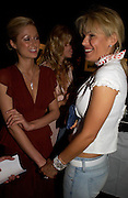 Paris Hilton and Diana Jenkins. 4 Inches, A  Photographic Auction in aid of the Elton John Aids Foundation hosted by Tamara Mellon and Arnaud Bamberger. Christie's. 8 King St. London. 25 May 2005. ONE TIME USE ONLY - DO NOT ARCHIVE  © Copyright Photograph by Dafydd Jones 66 Stockwell Park Rd. London SW9 0DA Tel 020 7733 0108 www.dafjones.com