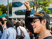 19 SEPTEMBER 2015 - BANGKOK, THAILAND:  An anti-coup protestor at Thammasat University. Hundreds of people protested against Thailand's military dominated government Saturday. The protest started with seminar about the 2006 coup that deposed popularly elected former Prime Minister Thaksin Shinawatra. After the seminar activists marched from Thammasat University to Democracy Monument, about 1 mile. Political gatherings of more than 5 people are banned by Thailand's military government and police tried to dissuade the protestors from finishing their march. Protestors ignored the police, who then stood by and watched but made no effort to intervene. At Democracy Monument protestors laid flowers and made speeches against the military. It was the largest anti-coup protest in Bangkok in more than a year.    PHOTO BY JACK KURTZ