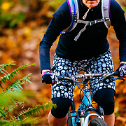 Heather Goodrich riding some late season singletrack covered with big leaf maple leaves just outside of Bellingham, Washington.