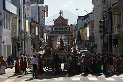 © Licensed to London News Pictures. 23/01/2016 Ipoh, Malaysia. Devotees follow the chariot carrying the deity Lord Murugan on its way to the Kallumalai Murugan Temple in Ipoh, Malaysia, during the Thaipusam Festival, Saturday, Jan. 23, 2016. Photo credit : Sang Tan/LNP