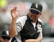 CHICAGO - JULY 27:  Manager Ozzie Guillen #13 of the Chicago White Sox waves to a fan during the game against the Detroit Tigers on July 27, 2011 at U.S. Cellular Field in Chicago, Illinois.  The White Sox defeated the Tigers 2-1.  (Photo by Ron Vesely)  Subject: Ozzie Guillen