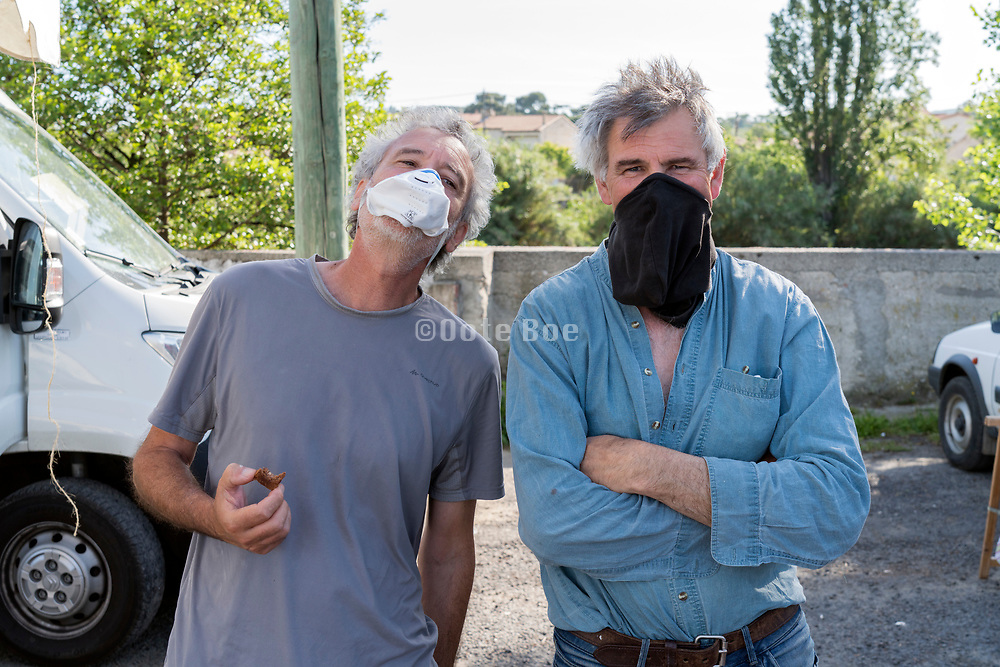 two men joking with improvised facemask during the Covid 19 crisis France Limoux April 2020