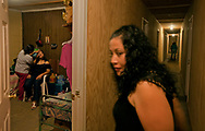 Before going out dancing, Erika Maria Lamas Mariscal gets her makeup done by roommate Maria Carrillo Guzman as LiLiana Manrique Zavala comes by to check on the ladies. All of the women live in the community house.
