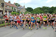 The start of the 7 km road race, part of the Kilburn Feast on 10th July 2016 in North Yorkshire, United Kingdom.