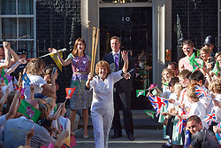 © licensed to London News Pictures. London, UK 26/07/2012. Florence Rowe leaves Downing Street with torch with support of David and Samantha Cameron and pupils. Photo credit: Tolga Akmen/LNP