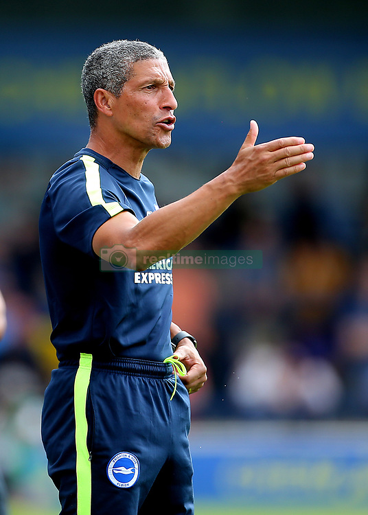 """Brighton Manager Chris Hughton shouts instructions to his players during a pre season friendly match at The Cherry Red Records Stadium, Kingston Upon Thames. PRESS ASSOCIATION Photo. Picture date: Saturday July 21, 2018. Photo credit should read: Mark Kerton/PA Wire. EDITORIAL USE ONLY No use with unauthorised audio, video, data, fixture lists, club/league logos or """"live"""" services. Online in-match use limited to 75 images, no video emulation. No use in betting, games or single club/league/player publications."""