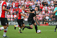 Football - 2017 / 2018 Premier League - Southampton vs. West Ham United<br /> <br /> Declan Rice of West Ham United gets pushed off the ball by Southampton's Oriol Romeu at St Mary's Stadium Southampton<br /> <br /> COLORSPORT/SHAUN BOGGUST
