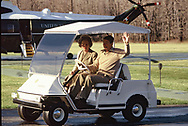 Camp David, MD. 1984/12/22  President Ronald Reagan  and  PM Margaret Thatcher in a golf cart at Camp David Maryland.<br /><br /><br />Photo by Dennis Brack