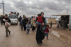 May 31, 2017 - Zaatari, Jordanian border, Syria - Syrian refugee mother walks a muddy street in the Zaatari refugee camp in Jordan, now the largest Syrian refugee camp in the world. the camp was supposed to provide temporary housing when the government and United Nations opened it in 2012. But since residents have not been able to leave, they have started 3,000 businesses and cities nearby have loosened employment restrictions. The settlement currently accommodates 85,000 Syrian refugees, half of them children. (Credit Image: © Alvaro Fuente/NurPhoto via ZUMA Press)